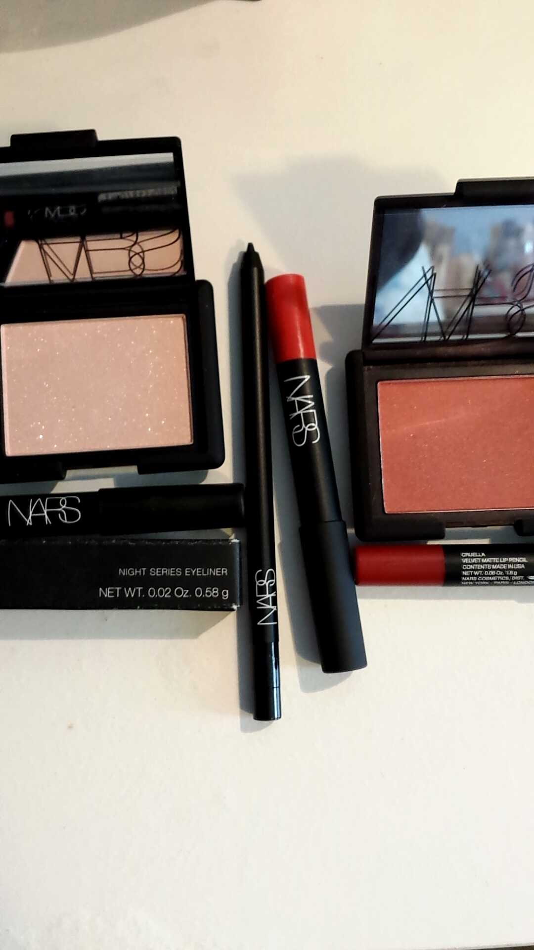 From L to R: NARS Blush in Reckless, NARS Night Series Eyeliner in Night Flight, NARS Matte Lip Pencil in Red Square, NARS Blush in Taos