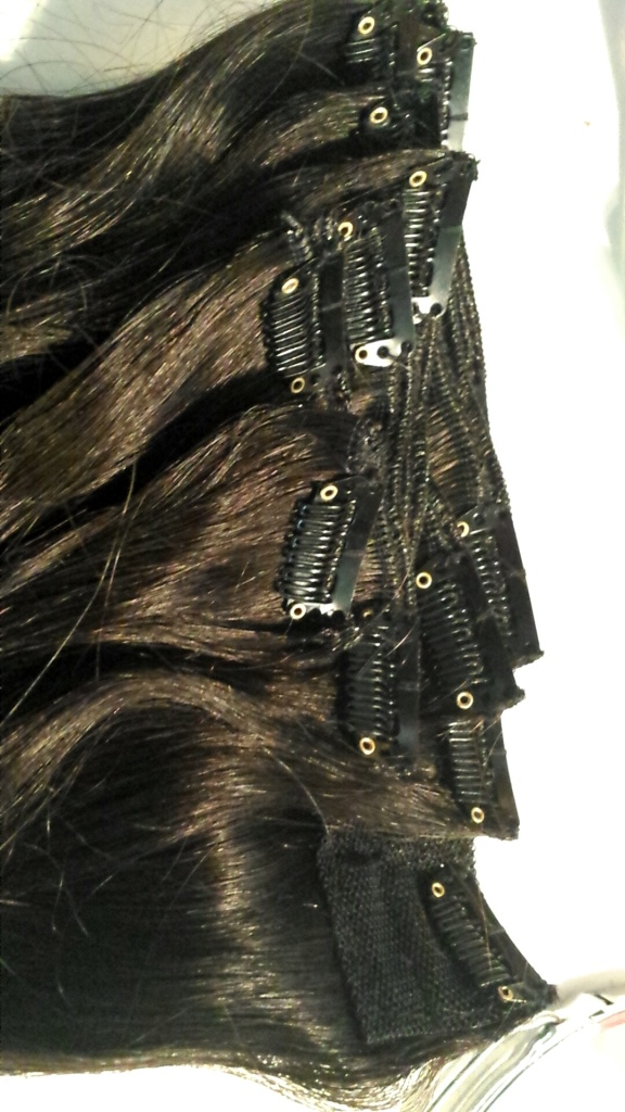 Irresistible Me Hair Extensions in Natural Black, measuring 18 inches and weighing 200 grams